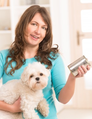 Woman feeding her dog